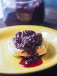 roll on yellow plate with cherry jam