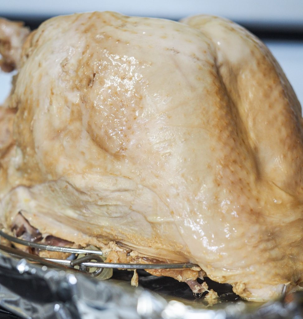 close side view of cooked turkey breast on cookie sheet