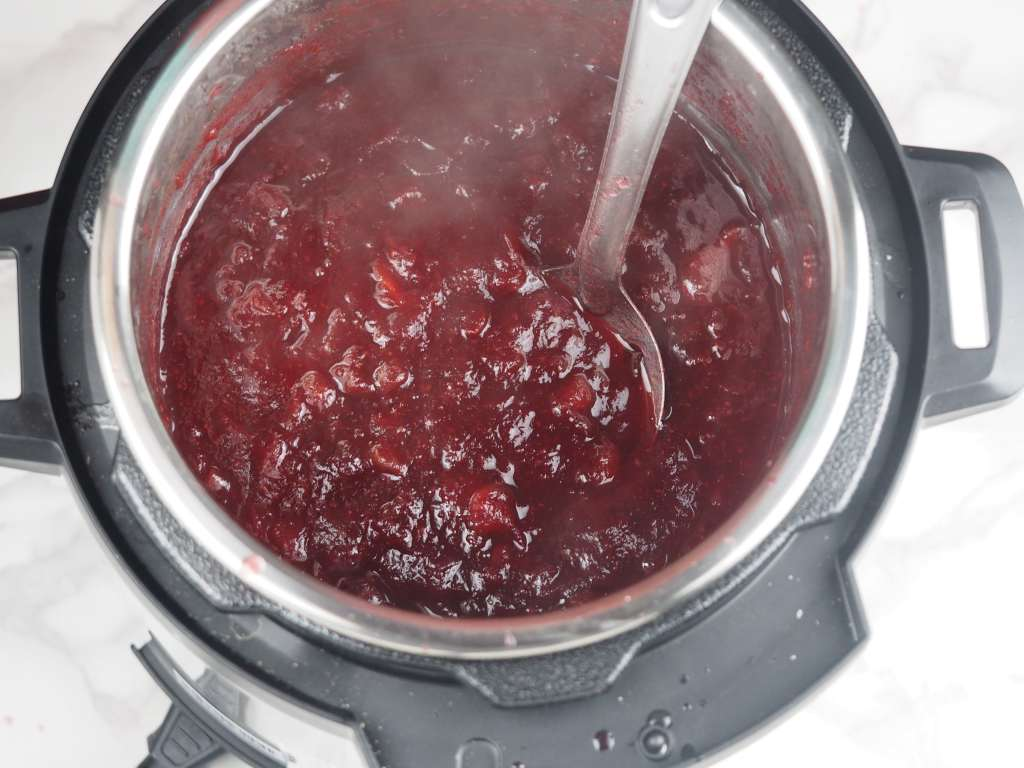 overhead shot of cooked cranberries sauce in Instant Pot