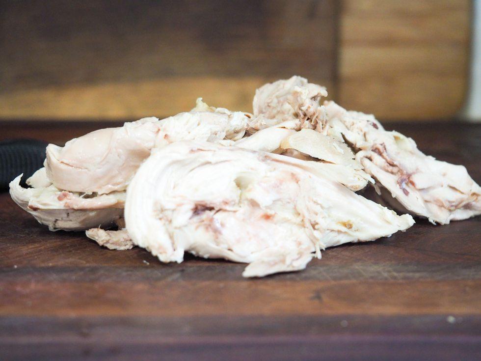 deboned chicken pieces on cutting board