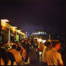 Bustling nightlife at the rooftop bar and restaurant Le Capitole