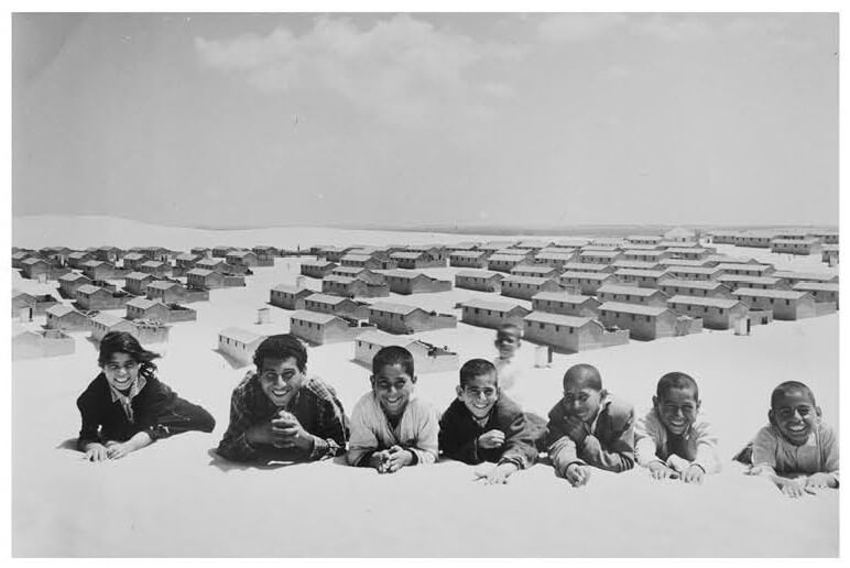 UNRWA photo of Palestinian refugees pose for picture in the New Amman refugee camp in Eastern Jordan, 1971 (Photo/G.Nehmeh, UNRWA Photo Archives)