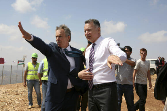 "Middle East Quartet envoy Tony Blair (L) speaks with Palestinian-American entrepreneur Bashar Masri, June 22, 2010 on a hill outside the West Bank city of Ramallah where the ""Rawabi"" residential project is expected to accommodate 40,000 people, in a 700-million-dollar project, which is partly financed by a Qatari construction company, 2010. (Photo: Eyad Jadallah/APA Images)"