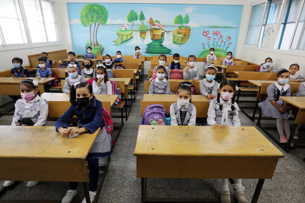Palestinian students return back to their school in the morning of the first day of the new year study, amid the coronavirus disease (COVID-19) outbreak, in Khan Younis in the southern Gaza Strip, on August 16, 2021. (Photo: Ashraf Amra/APA Images)
