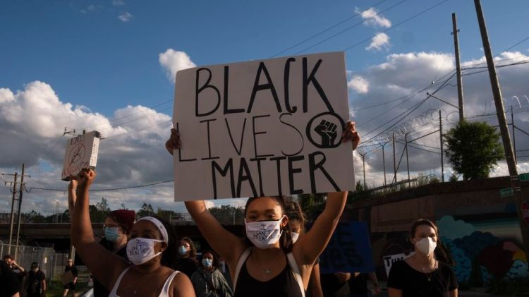 Black Lives Matter protesters in Detroit. In January, an innocent Black man was arrested by the Detroit Police Department because of a facial recognition algorithm.