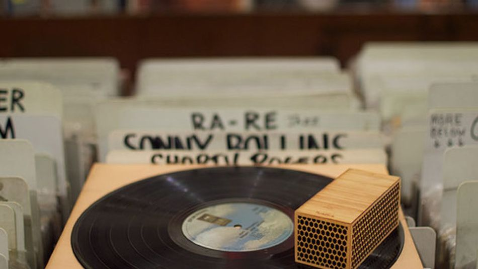 This wooden block is actually a wireless record player — all you need is a flat surface