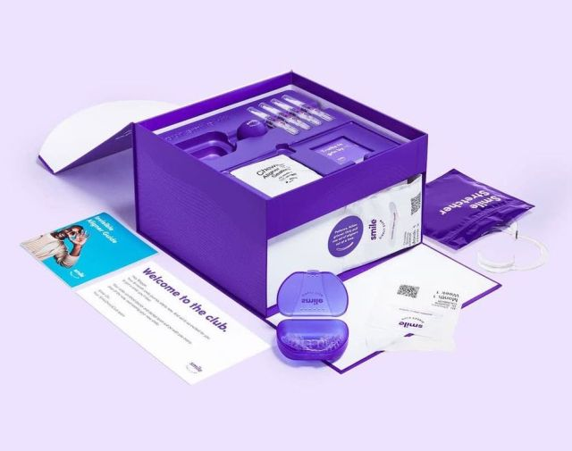 "SmileDirectClub's aligners arrive in a brightly hued box it describes as ""blurple."""