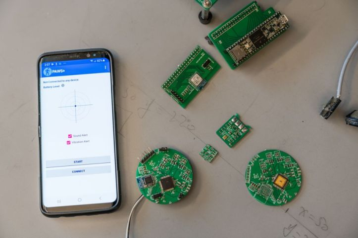 Jiang's lab re-engineers commercial headphone using custom circuit boards that help an app signal road dangers.