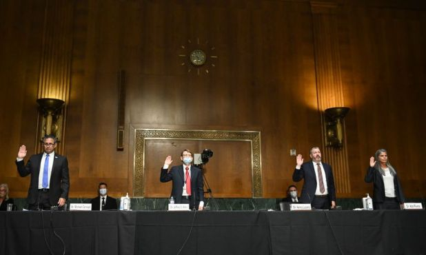 Artificial Intelligence: Federal Bureau of Prisons Director Michael Carvajal, left, is sworn in before a June Senate Judiciary Committee hearing on incarceration during COVID-19.