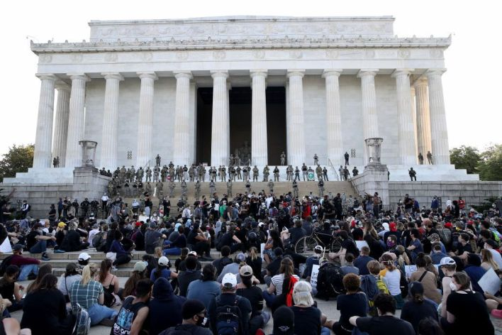 WASHINGTON, DC - JUNE 02: Members of the D.C. National Guard stand on the steps of the Lincoln Memorial monitoring demonstrators during a peaceful protest against police brutality and the death of George Floyd, on June 2, 2020 in Washington, DC. Protests continue to be held in cities throughout the country over the death of George Floyd, a black man who was killed in police custody in Minneapolis on May 25. (Photo by Win McNamee/Getty Images)