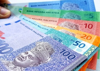 Currency : Ringgit fluctuates against USD