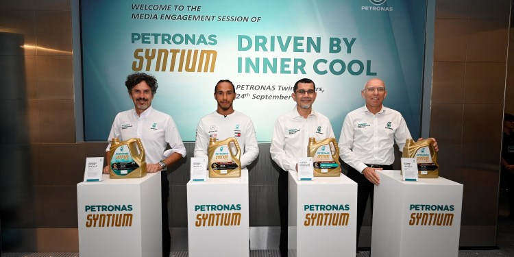 Mercedes AMG PETRONAS Formula 1 Driver, Lewis Hamilton (2nd from left), with (L-R PETRONAS Lubricants International (PLI) Managing Director and Group Chief Executive Officer, Giuseppe D'Arrigo; PETRONAS Dagangan Berhad's Managing Director and Chief Executive Officer as well as PETRONAS Vice President, Marketing, Downstream Business Dato' Sri Syed Zainal Abidin Syed Mohamed Tahir; and PLI Chief Technology Officer, Eric Holthusen. Hamilton was in Kuala Lumpur for the unveiling of the new PETRONAS Syntium with ◦CoolTech™ to media yesterday.