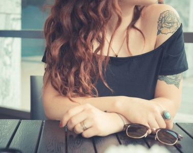 What does a tattoo cost? Young tattooed woman.