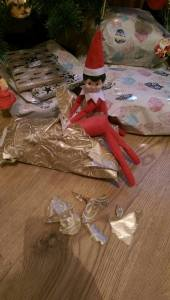 Elf on The Shelf Unwrapping Presents