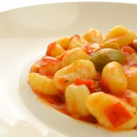 Gnocchi with fresh tomatoes,  green olives and smoked mozzarella