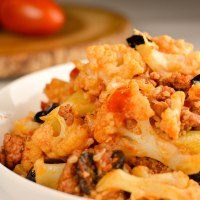 Cauliflower with sausage and olives