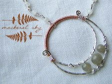 Crescent moon in sterling silver, copper, labradorite, and moonstones. 2013