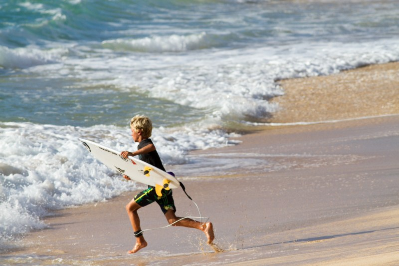 Luke running to surf