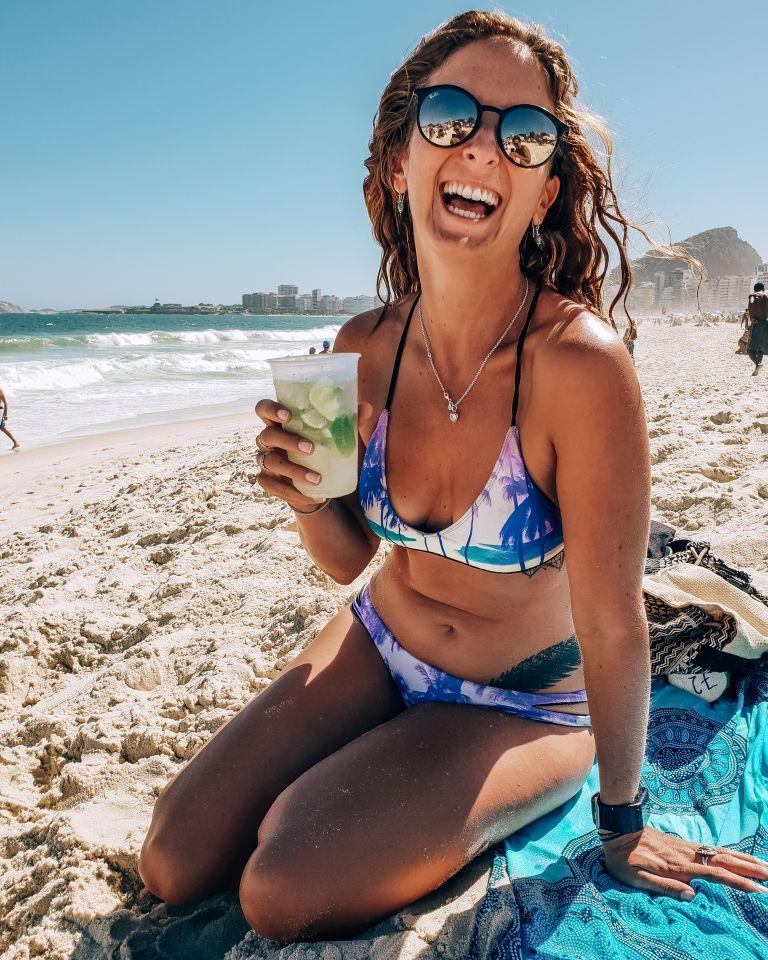 Copacabana Beach with girl with Caipirinha Rio de Janeiro Brazil