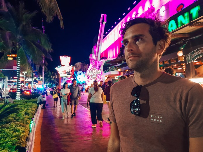 Man looking at City Lights in Cancun Mexico North America