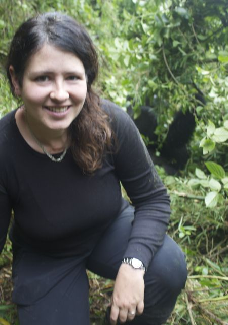 Me posing with a silverback of the Sabyinyo troop in Volcanoes National Park, Rwanda