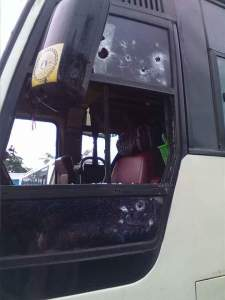Front part of bus hit by bullets