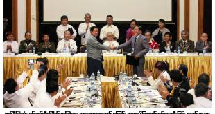 Union minister U Aung Min and NMSP vice-chairman Nai Hongsar shaking hands
