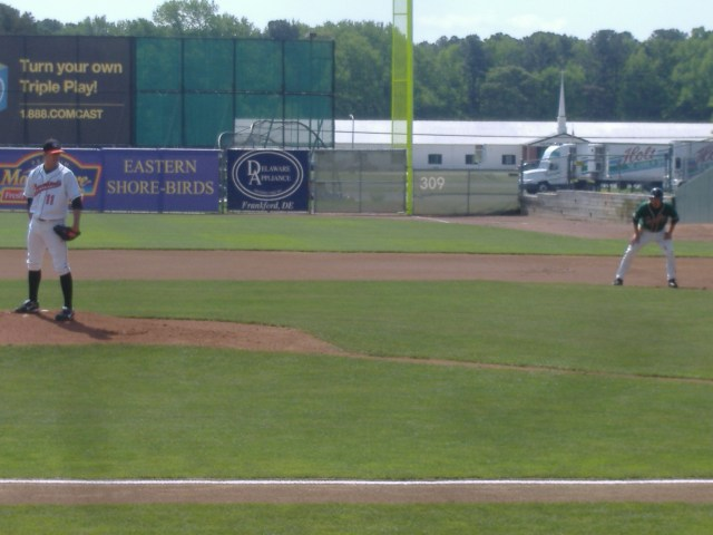 In this picture taken May 12th, Ryan O'Shea keeps a wary eye on Greensboro runner Kevin Mattison. He would pick Mattison off before the next pitch.