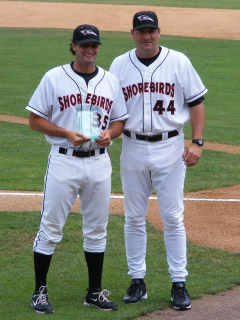 An enjoyable part of Ryan Minor's job is to hand out various organization awards. Here Minor (right) presents the Orioles Pitcher of the Month award to Shorebird hurler Nathan Moreau.