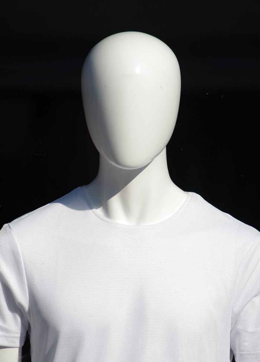 person in white crew neck shirt