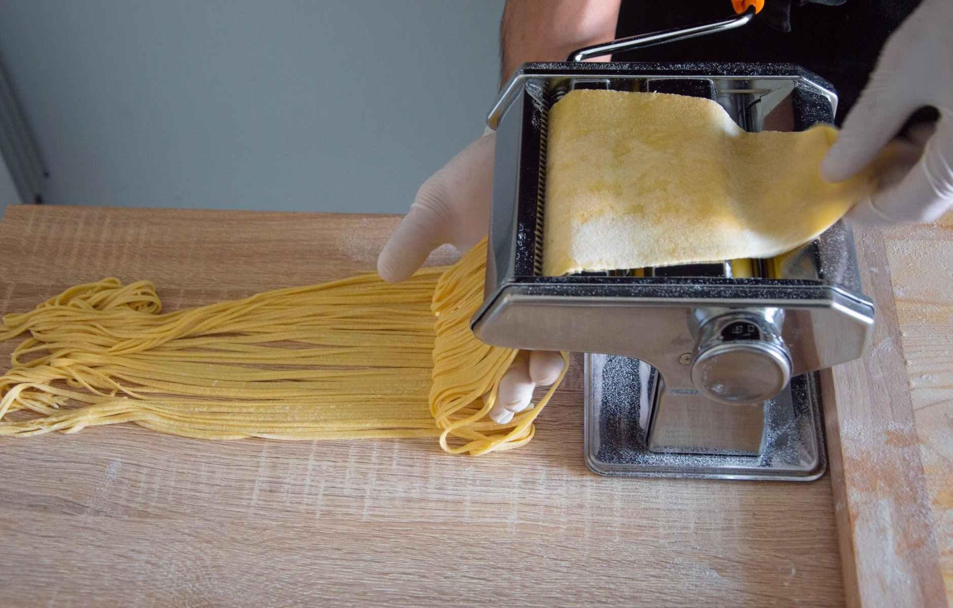 a person making a spaghetti pasta