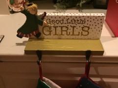 Leftover wood, tissue paper, Mod Podge, and broken ornaments = $4 stocking holder!