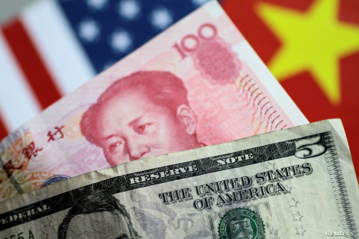 FILE - U.S. Dollar and China Yuan notes are seen in this picture illustration, June 2, 2017.