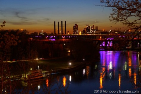 The rebuilt 35W bridge reflecting purple in the Mississippi River