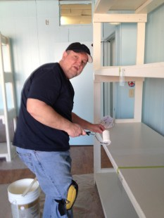 PAUL TOUCHING UP PAINT ON MEMBERS SHELVES