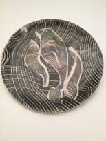 hand built manatee plate made by combing through layers of colored slip