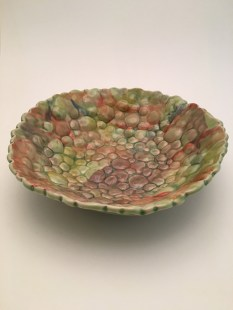 green bubble bowl. Hand built with colored stoneware and glazed in green celedon