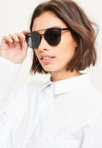 lunettes-de-soleil-noires-rondes-monture-mtal