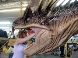 A crewmember works on the full-size Dragon.