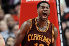 Cleveland Cavaliers' Tristan Thompson celebrates after dunking during the final seconds of overtime in an NBA basketball game against the Chicago Bulls in Chicago, Friday, Oct. 31, 2014. Cleveland won 114-108. (AP Photo/Paul Beaty)
