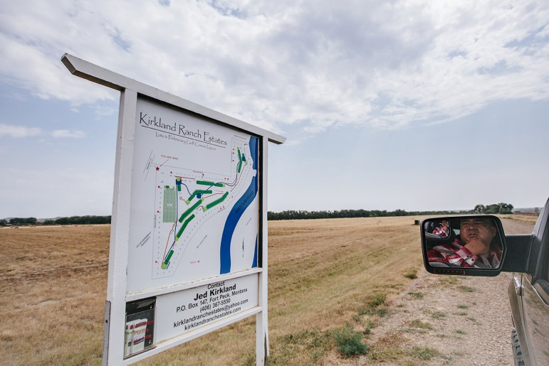 Lance Fourt Star stops at a sign for an undeveloped housing project that is rumored to be the site of a future camp for Keystone XL oil pipeline workers.