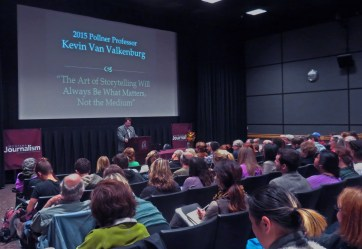 Kevin Van Valkenburg speaks to a crowded theater
