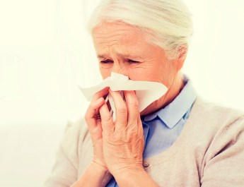 Senior woman with cold or flu