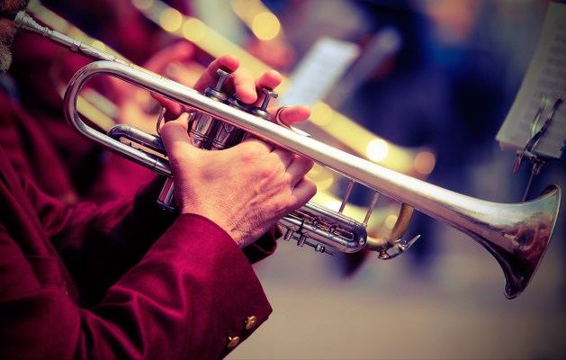 Brass man plays his trumpet