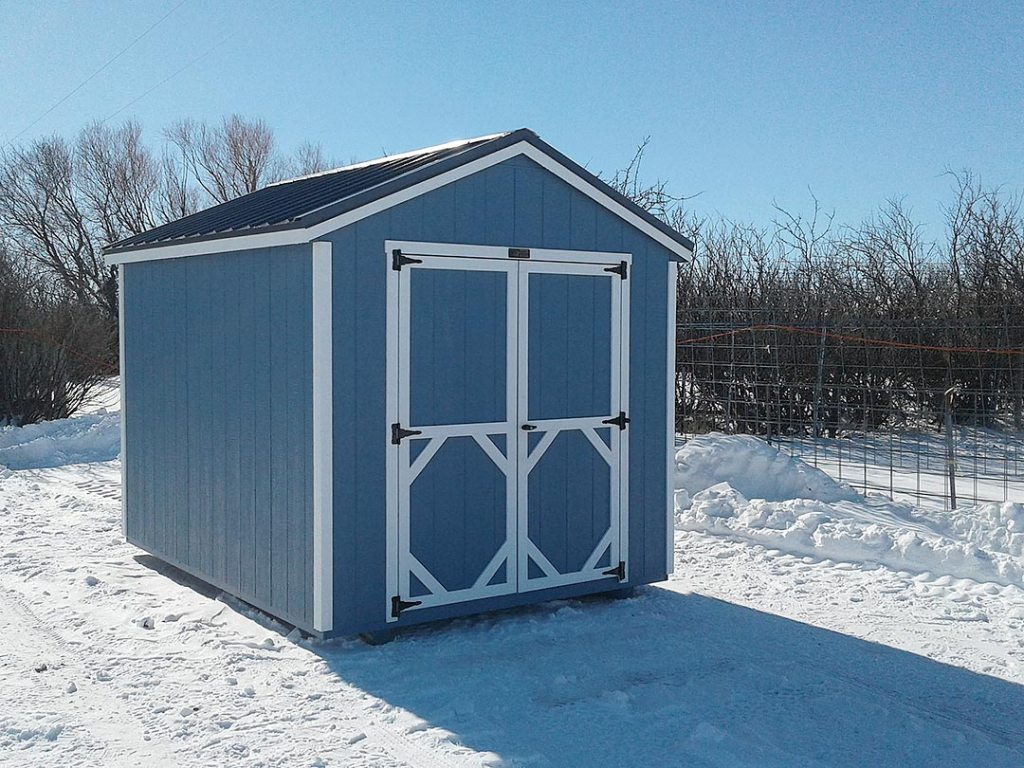 Blue storage shed with white trim