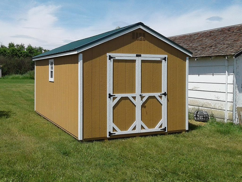 Terra Brown storage shed with white trim