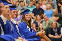 Leah Earnest (class president) listens intently during the ceremony.