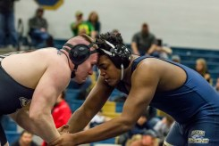 Christiansburg's Xavier Wright (right) grapples with his opponent as they both work on the take down during this weekend's Region 3C wrestling tournament. The Blue Demons would dominate the event, taking another regional title.