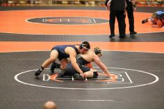 Photos courtesy of Blue Demon Wrestling Club Ty Kwak won the state individual title in the 195-pound class with a 4-3 decision over Staunton River's David Wilson.