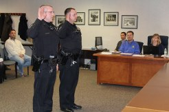 Two new police officers were sworn in during Tuesday night's Christiansburg town council. Pictured are: Jarrett Rhodes (left) and Casey Lusk.